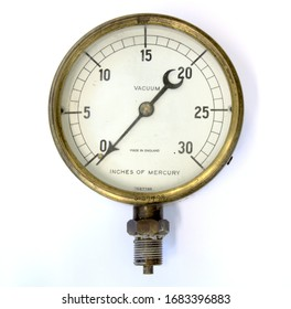 Old vintage brass pressure gauge on a white background