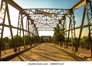 Old vintage bridge across a river somewhere in Europe  - Shutterstock ID 2008291127