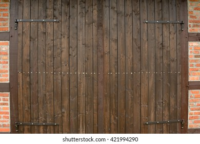 Old vintage brown wooden barn gate