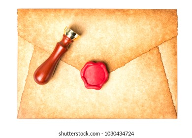 Old vintage burned envelope letter with wax seal and stamp isolated on a white background