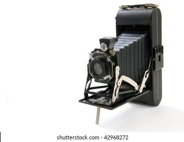 An old vintage camera on a white background