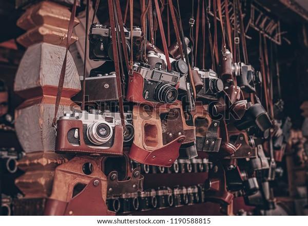 old vintage cameras at flea market. Collection of antique retro-film analog cameras. many kinds of different vintage photocameras.