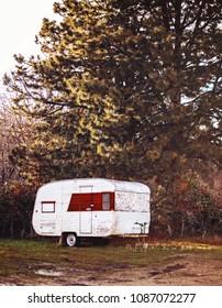 old vintage camper abandoned in an alley