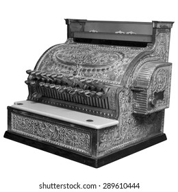 Old vintage cash register in black and white over white.