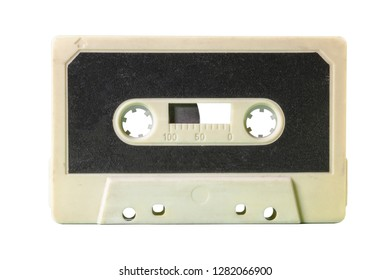 An old vintage cassette tape from the 1980s (obsolete music technology). Sand white plastic body, carbon black paper label.