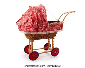 An old vintage childrens doll stroller over a white background