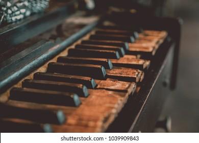 Old vintage classic black piano, Broken antique piano keyboard