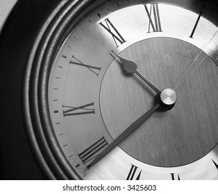An old vintage clock in grayscale tones.