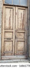 Old vintage closed wooden door in the streets of old town, Tbilisi.