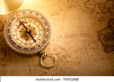 Old vintage compass with vintage map