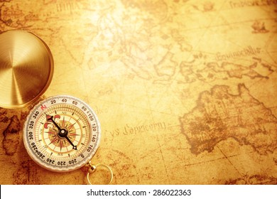 Old vintage compass on vintage map