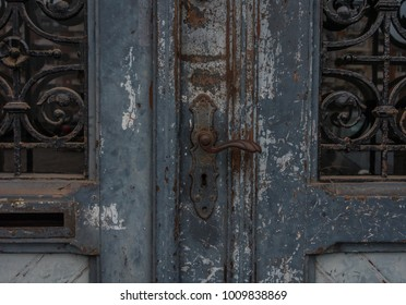 The old and vintage door of a building .