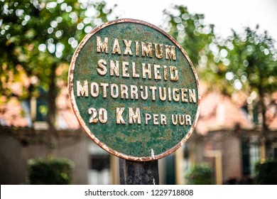 Old vintage dutch language road sign of iron with green patina and rust