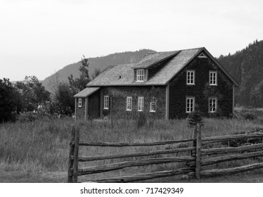 An old vintage family house in the meadow - black and white photos