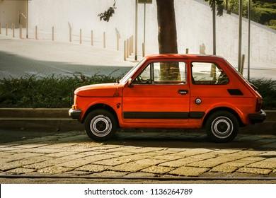 An old vintage Fiat 126 parked along street in Milan. Italy-Milan 22 June 2018