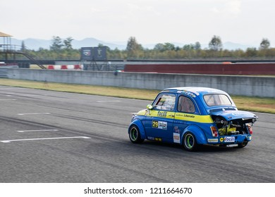 An old vintage Fiat 500 Abarth speeding on Tazio Nuvolari circuit during a competition. Italy-Cervesina 07 October 2018