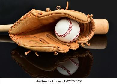 Old Vintage with  glove baseball on black background.