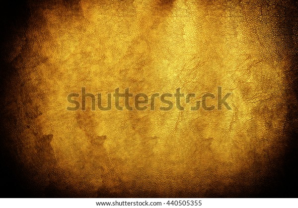 Old vintage gold luxury leather texture closeup can be used as background