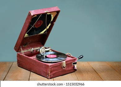 Old vintage gramophone player with a vinyl record and negative space