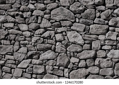 The old vintage grayish stone wall seamless pattern background texture, Spring in VA USA.
