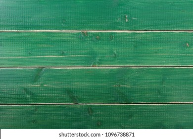 Old vintage green painted wood plank background surface