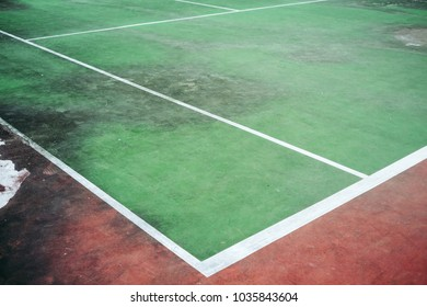 Old and vintage of green tennis court, The field line and corner of court, Dirty ground of tennis court.