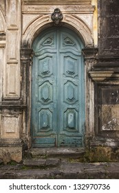 Old vintage green wooden church door.