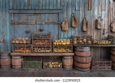 Old, vintage grocery store and marketplace with old, rugged baskets and barrels.