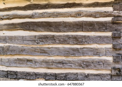 Old vintage hand hewn log house wall background