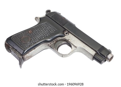 Old vintage handgun on white