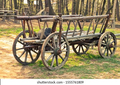 Old vintage horse or donkey four-wheeled cart. Horse-drawn cart with hay, close-up photo.