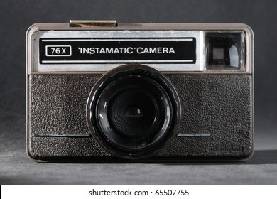 old vintage instamatic camera isolate on grey foam