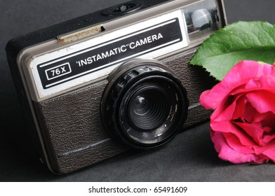 old vintage instamatic camera with pink roses