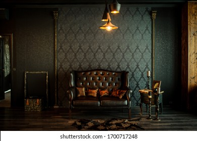 Old vintage interior with leather sofa, wood table and ceiling light.