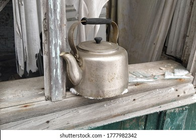 old vintage kettle. vintage teapot and old rural house