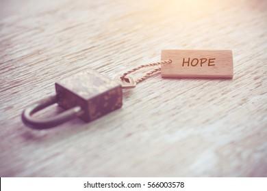 Old or vintage key and label. Hope concept