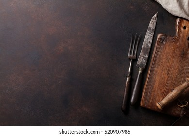 Old vintage kitchen utensils on stone table. Top view with copy space