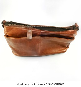 old vintage leather bag brown color casual fashion style with stitch line texture and broken zipper close up on white background studio shot, image for leather repair shop or hand craft DIY project