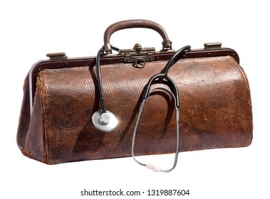 Old vintage leather doctors bag with stethoscope dangling over the side over white in a healthcare and medical concept