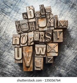 Old vintage letterpress type letters alphabet grunge background