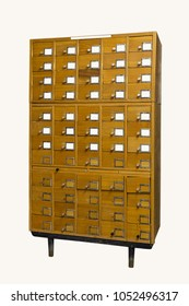 Old Vintage Library Card Catalog on white background. An old style wooden cabinet of library card index drawers with label holders and blank labels facing front
