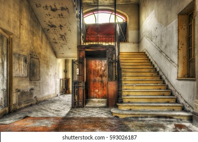Old vintage lift at abandoned hotel lobby, HDR processing