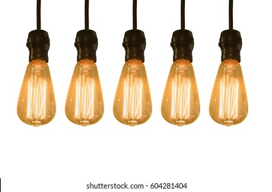 Old vintage light bulb isolated on white background.