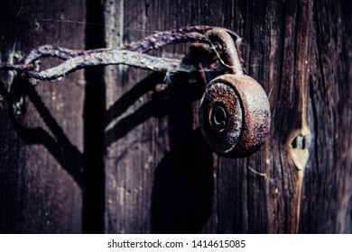 Old vintage lock with cobwebs and rust