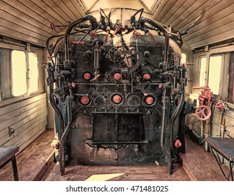 Old vintage locomotive cabin wide interior detail  faded photograph burned colors view