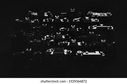 Old vintage manual 35mm film SLR mirror photography camera set collection dark background