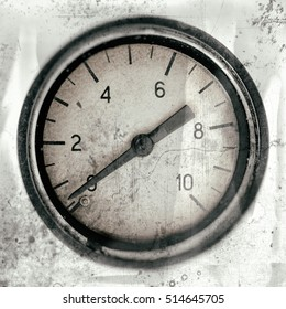 The old vintage measuring device with a scale from 0 to 10, and the arrow is stuck at zero. Stylised as aged old b&w photos. Industrial background.