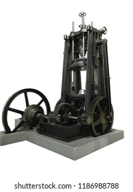 Old vintage metal press machine isolated over white background.