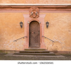 old vintage moated castle in Germany, Bavaria, Spessart, Mespelbrunn, detail shot of the entrance with weapon and lantern lamps, close up shot