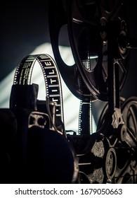 Old vintage movie projector on a dark background